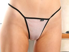 Cute tender asiangirl posing in her fishnet thong